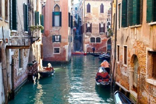 beautiful-colorful-canal-in-venice-with-parked-gondolas-near-traditional-architecture-italy